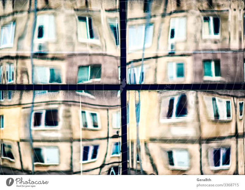 crooked reflection of houses in a glass window House (Residential Structure) Building Architecture Street Line Old Blue Yellow Colour background blur bowed City