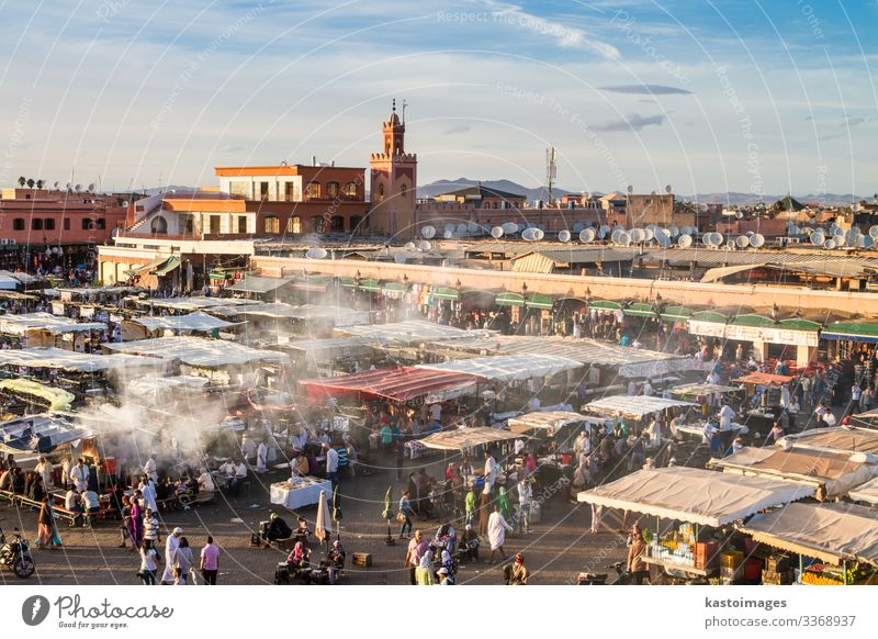 Jamaa el Fna market in sunset, Marrakesh, Morocco, Africa. Vacation & Travel Tourism Trip Business Culture Landscape Town Places Building Tradition jamaa fna