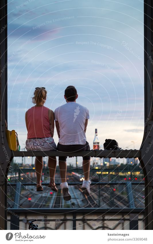 Couple on romantic date on railway bridge, Munich, Germany. Bottle Lifestyle Joy Beautiful Vacation & Travel Summer Woman Adults Man Skyline Bridge Street