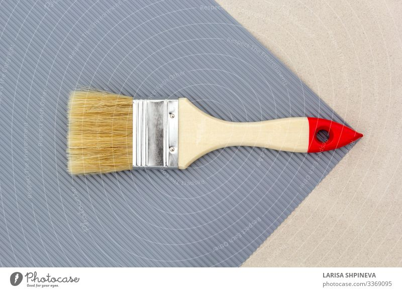 Paint brush for repair on gray background. Top view. Design House (Residential Structure) Decoration Work and employment Tool Hand Art Gloves Tin Wood Metal