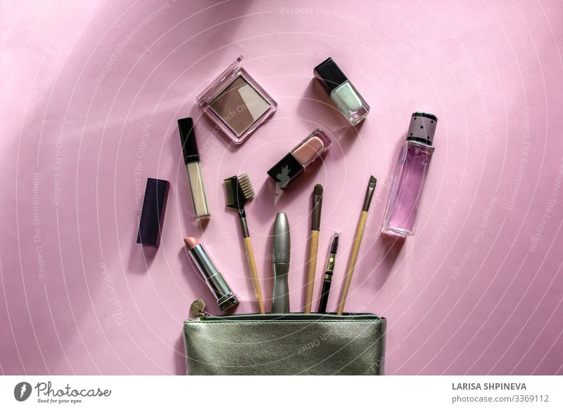 Cosmetic bag with makeup products on pink background.Top view Luxury Design Beautiful Skin Cosmetics Make-up Lipstick Decoration Desk Feminine Woman Adults