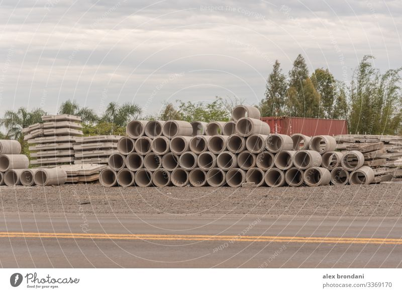 A stack of stacked concrete pipes for use in road works. architectural architecture background beam block bridge building cement city column columns