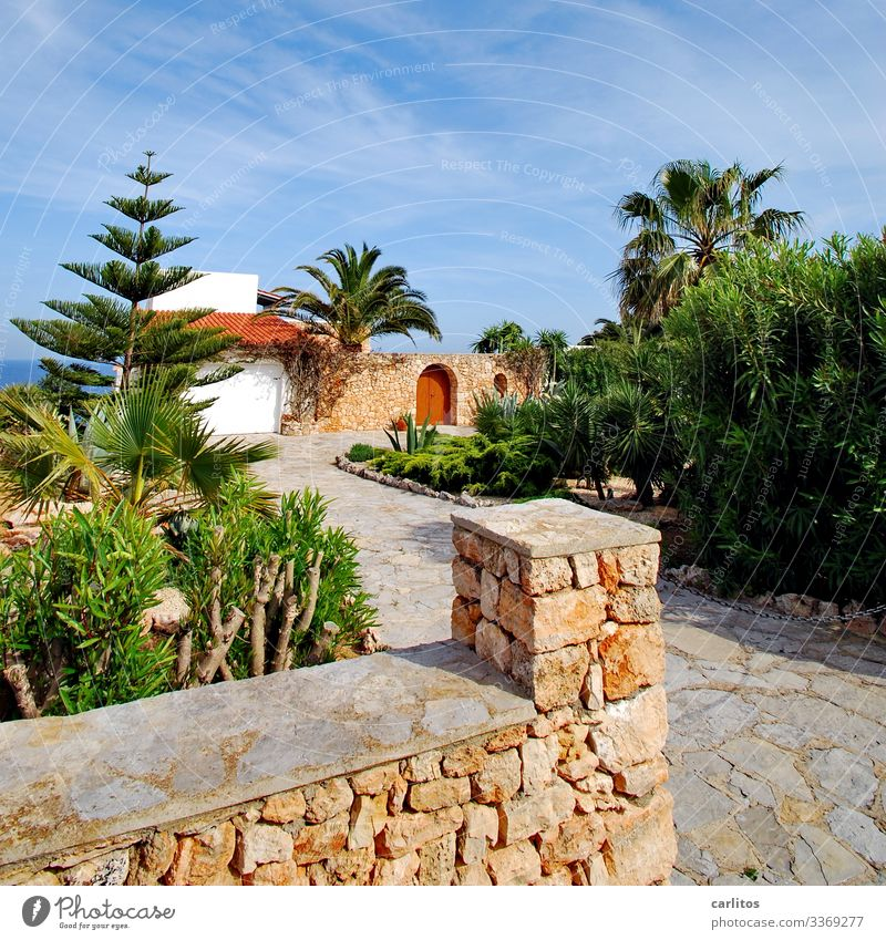 Natural stone wall in front of mediterranean villa at the sea Spain Balearic Islands Majorca Wall (barrier) Mares Villa palms Goal Archway Door locked Safety