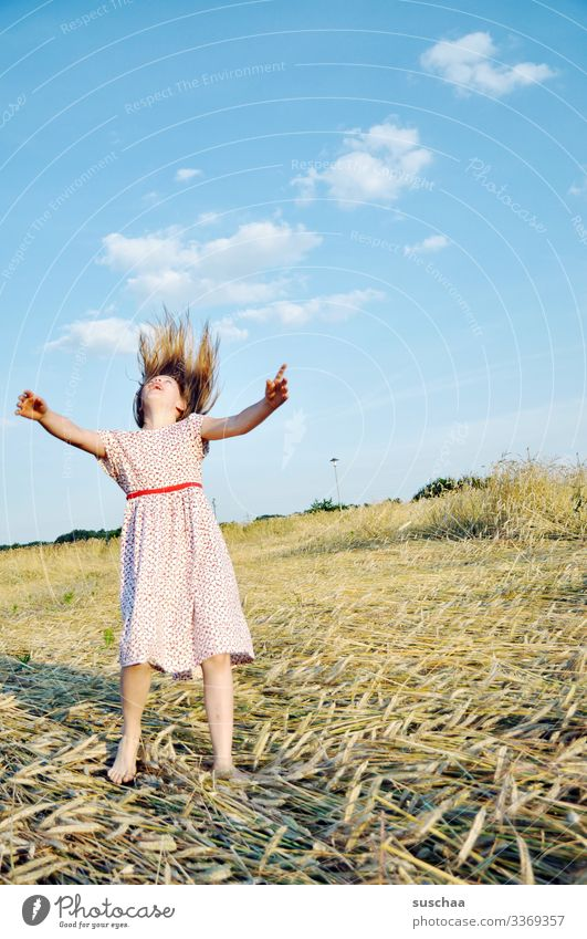 girl in summer dress on a straw chopper playing a little bit crazy and dancing around like crazy Child Girl Summer Field acre Summer dress Action Infancy Hand