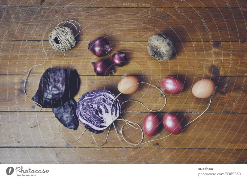 Ingredients Rustic Easter need Easter egg dyeing recipe Wooden floor String Onion Red beet red cabbage Egg boiled eggs colorful eggs Multicoloured