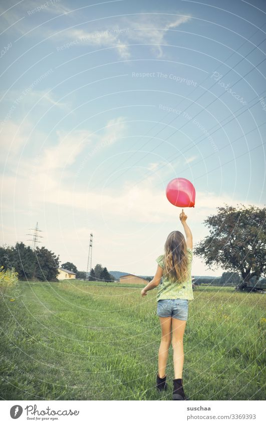 touch as a flight aid | lifted off Child Girl Infancy Summer Exterior shot Landscape Field Meadow Village Hair and hairstyles Balloon Tree Shorts Rear view