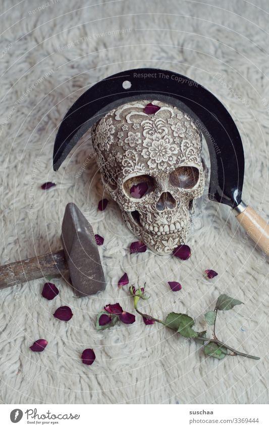 skull with sickle and rose leaves on flokati Death's head Skeleton Creepy Force policy Revolution Photochallenge Eerie Hallowe'en Weapon Tool tart peak Harm