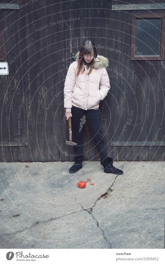 fotochallenge: teenager looks at a muddy overripe tomato and thinks about crushing it with a hammer Photochallenge Youth (Young adults) Young woman Girl Tomato
