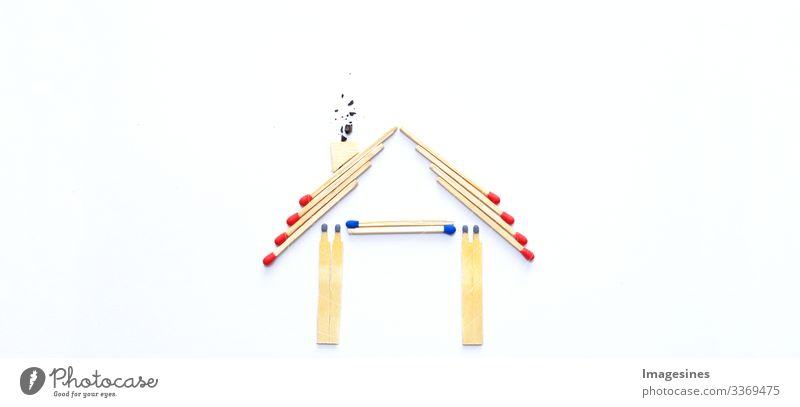 fire insurance, shape of the house made of matches. abstract house made with matches on white paper background. Concept of home protection insurance with the importance of smoke detectors