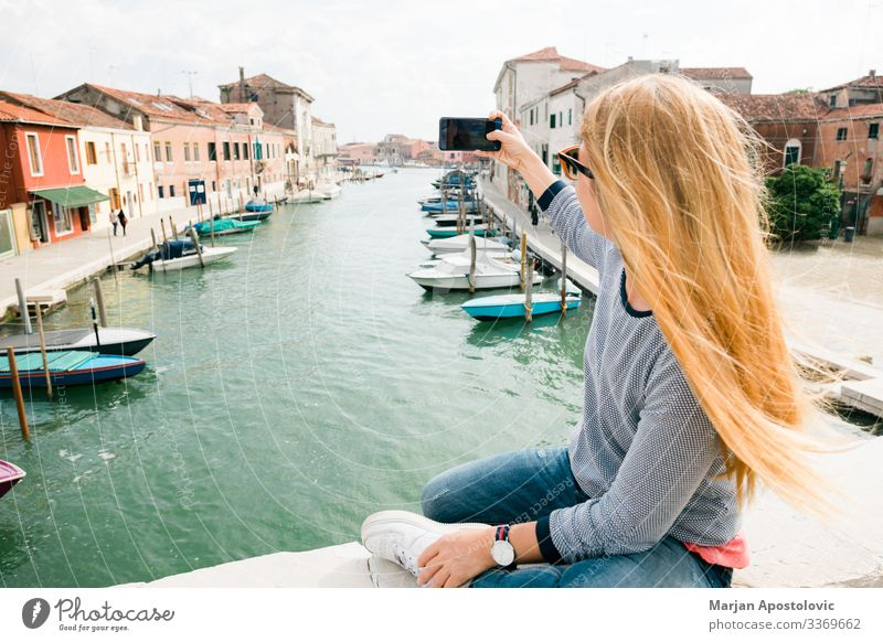 Young woman taking a photo on the bridge in Murano in Venice, Italy Lifestyle Joy Vacation & Travel Tourism Trip Adventure Freedom Sightseeing City trip