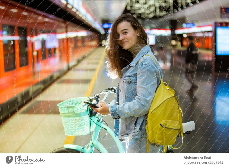 Teenager girl with backpack and smartphone on metro station Decoration Blog Internet Easygoing Casual clothes Chat Chatty City Destination Europe Finland