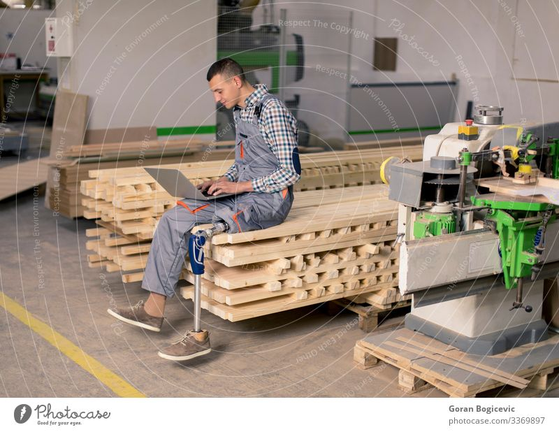 Disabled young man working at furniture factory Human being Youth (Young adults) Man Young man 18 - 30 years Adults Business Work and employment Industry Safety