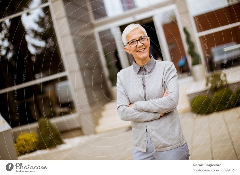 Outdoor portrait of happy senior businesswoman Lifestyle Happy Success Work and employment Office Business Company Human being Woman Adults Female senior