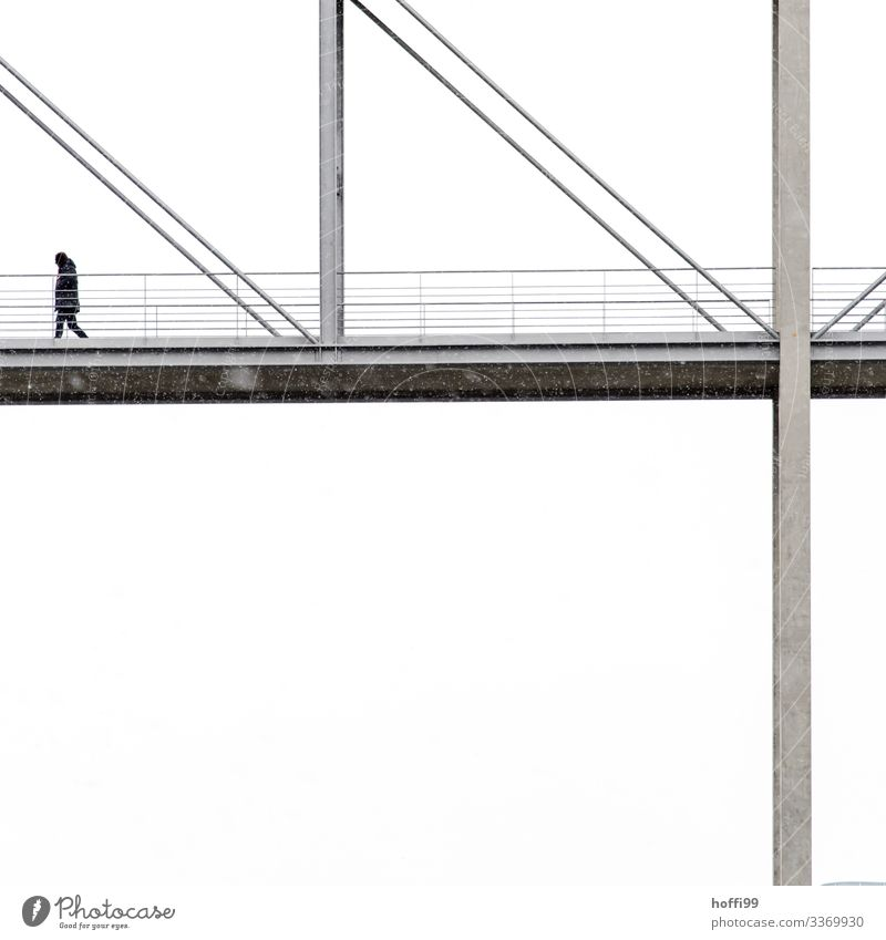 an anonymous person walks over a fragment of a bridge with white background in light snowfall Human being 1 Winter Bad weather Fog Snow Snowfall Capital city