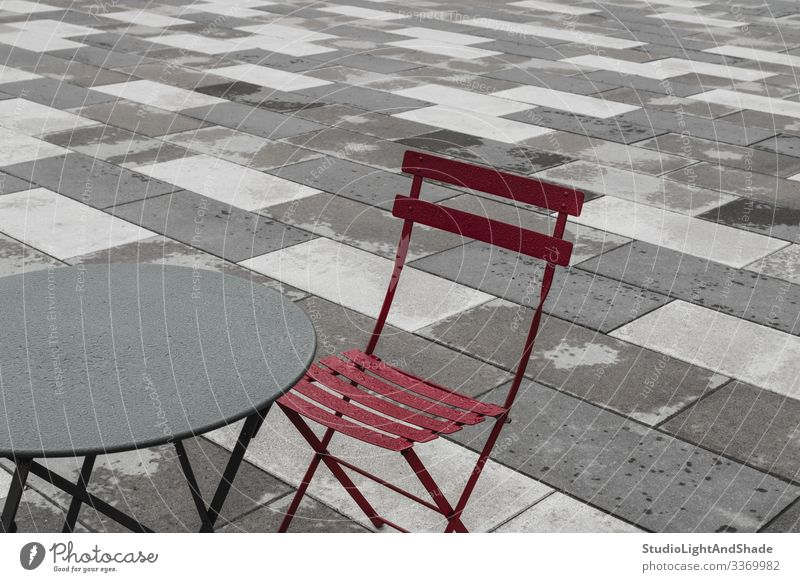 Outdoor cafe with red chair and table Furniture Chair Table Rain Town Street Stone Metal Drop Dark Simple Wet Gray Red Café Cafeteria bistro exterior Europe