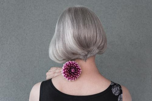 Lady with beautiful silver hair and red dahlia Lifestyle Elegant Style Beautiful Hair and hairstyles Health care Gardening Human being Woman Adults Flower