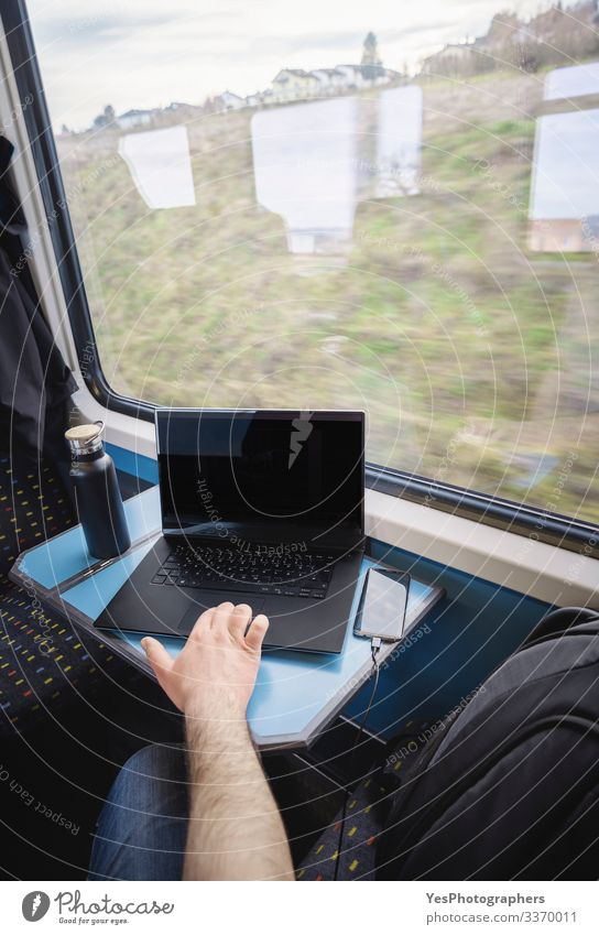 Using laptop on train travel. Train interior. Business commuting Vacation & Travel Tourism Trip Chair Table Work and employment Transport Passenger traffic