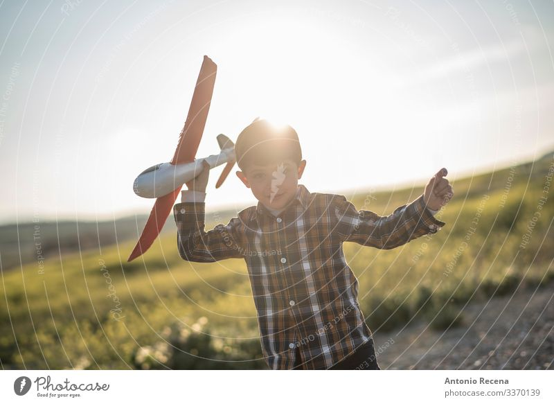 Flare plane Playing Vacation & Travel Adventure Child Pilot Boy (child) Infancy Flower Meadow Street Airplane Toys Flying Speed Sunset plaid shirt kid handsome