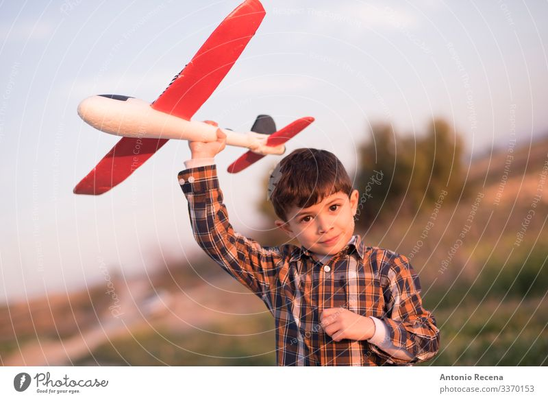 Plane boy Playing Vacation & Travel Adventure Child Pilot Boy (child) Infancy Flower Meadow Street Airplane Toys Flying Speed Sunset plaid shirt kid handsome