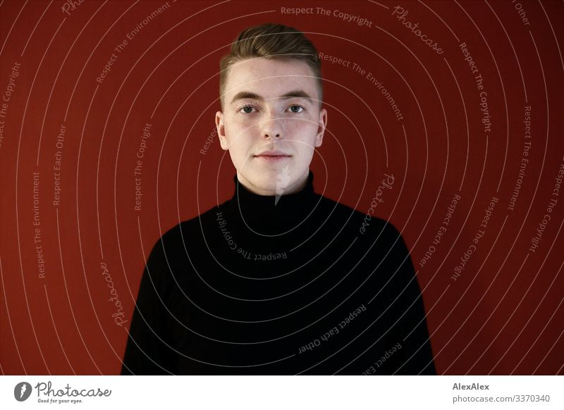 Portrait of a young man in front of a red wall Lifestyle Style Beautiful Well-being Flat (apartment) Young man Youth (Young adults) Face 18 - 30 years Adults