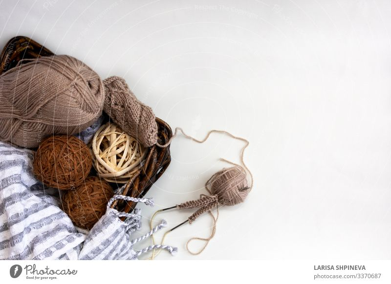 Knitting needles of yarn gray brown wool yarn in wicker basket Design Leisure and hobbies Handicraft Winter Ball Work and employment Craft (trade) Warmth Soft