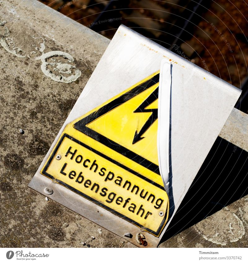high voltage Rail transport Concrete Metal Plastic Sign Characters Signage Warning sign Line Old Broken Brown Yellow Gray Black Silver Emotions Stupid Risk