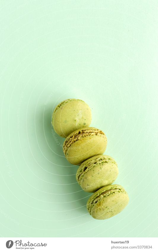 Homemade green macarons seen from above Food Dessert Candy Elegant Delicious Green Colour Tradition french Macaron sweet Snack colorful Bakery Tasty Gourmet