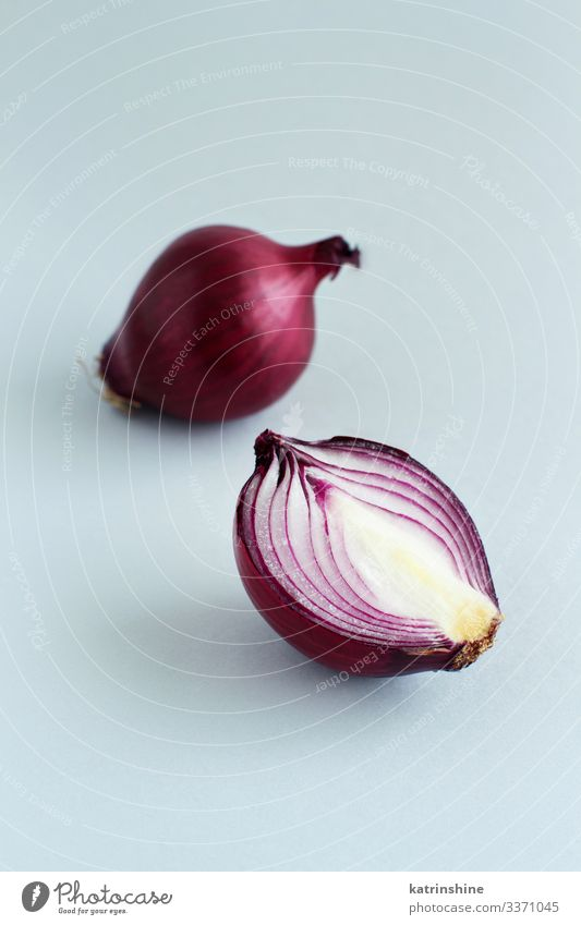 Purple onion on a light grey background Vegetable Vegetarian diet Fresh Natural Gray Red White Onion Sliced Half food healthy Raw Organic Ingredients Mature