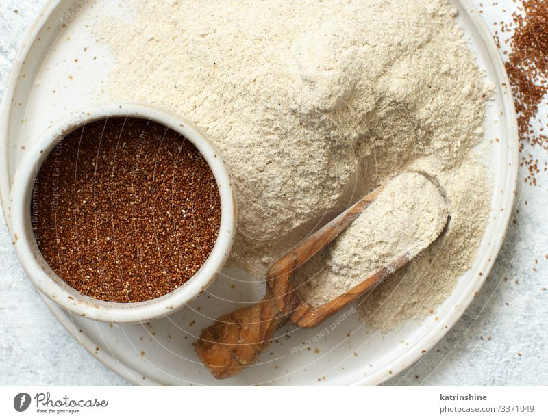 Teff flour and teff grain with a spoon Vegetarian diet Diet Plate Spoon Wood Above Flour food african gluten free preudocereal ceramic Cooking healthy Heap