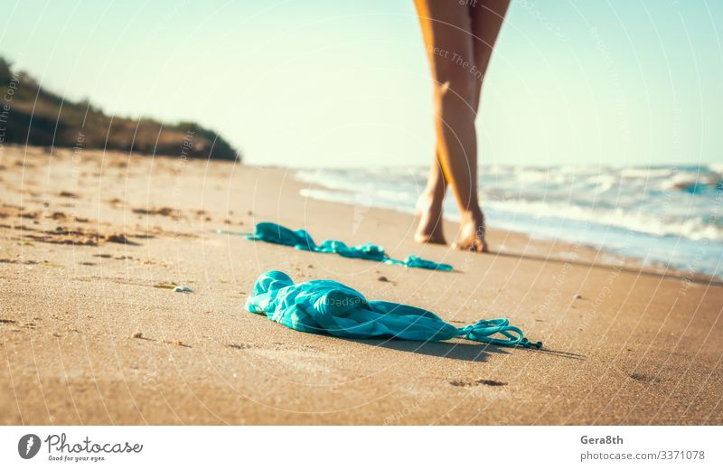 swimsuit in the sand on the beach near the sea surf Summer Beach Ocean Waves Young woman Youth (Young adults) Nature Sand Sky Horizon Warmth Coast Clothing Hot