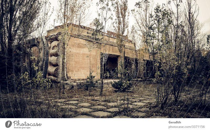abandoned empty cinema with the name Prometheus in Chernobyl Autumn Tree Old Gloomy Dangerous Environmental pollution Destruction Ukraine abandoned city