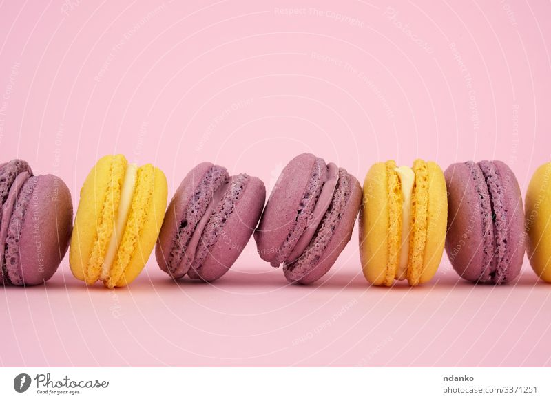 yellow, purple round baked macarons Cake Dessert Candy Gastronomy Delicious Yellow Pink Colour Tradition Almond assorted assortment Baking Bakery biscuit