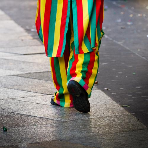 A Jeck Carnival Masculine Feminine 1 Human being Pedestrian Sidewalk Carnival costume Line Stripe Feasts & Celebrations Going Authentic Happiness Funny Positive