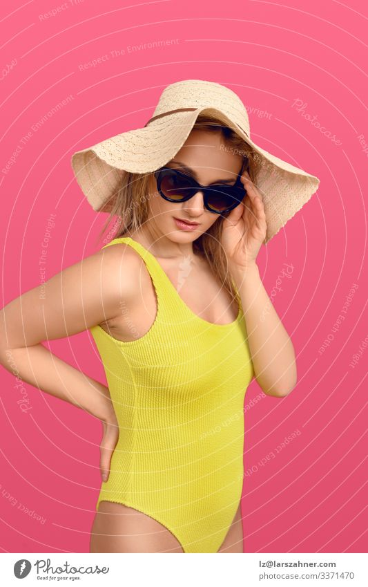 Trendy young woman in a yellow swimsuit Lifestyle Body Skin Relaxation Vacation & Travel Tourism Summer Sunbathing Woman Adults 1 Human being 18 - 30 years