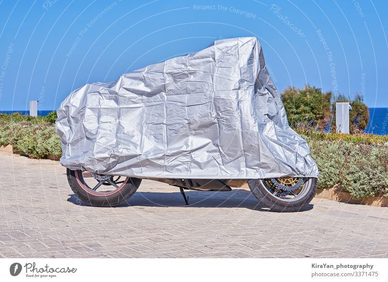 Waterproof cover for motorcycle with silver surface Vacation & Travel Tourism Sun Engines Landscape Weather Rain Park Transport Street Vehicle Motorcycle