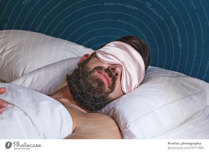 Caucasian bearded man in eyemask sleeping in bed Lifestyle Face Relaxation Vacation & Travel Bedroom Human being Man Adults Fashion Accessory Sleep Dream Soft