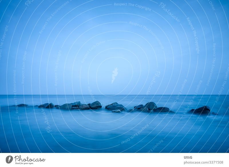 Blue Sea - Blue shimmering Baltic Sea after sunset in the time of the blue hour at Rabylille Beach, Moen Island, Denmark. Ocean Coast Nature Water silent