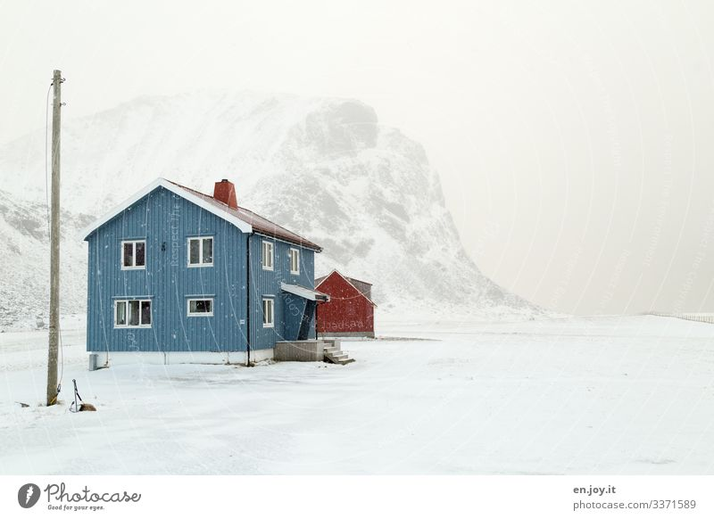 Blue house in the snow in front of snowy mountain Norway House (Residential Structure) Snow Winter Lofotes Scandinavia winter landscape stream Power pole