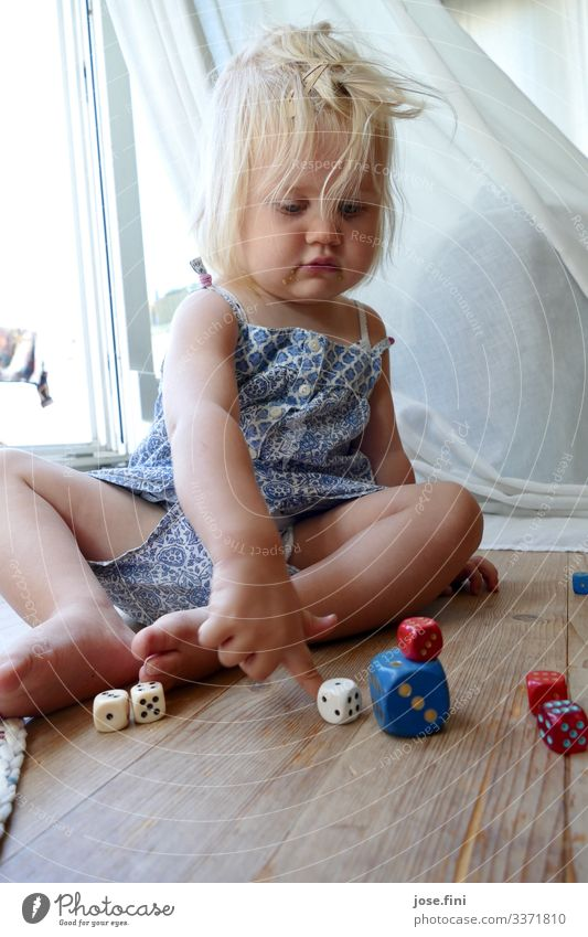 Dice game IV Joy Healthy Playing Children's game Children's room Study Feminine Toddler Girl Infancy Body Fingers Blonde Movement Think Sit Curiosity Blue Red