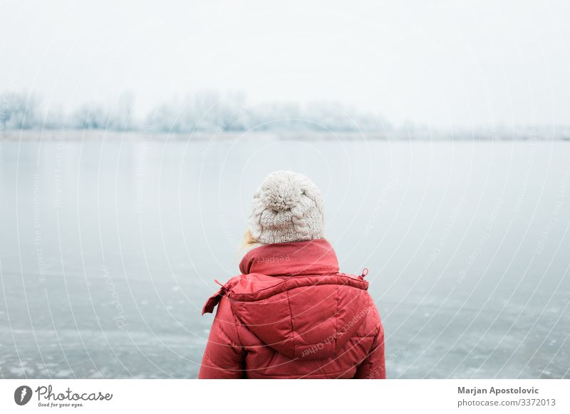 Woman looking at a frozen lake in winter morning Lifestyle Adventure Freedom Winter Human being Feminine Young woman Youth (Young adults) Adults 1 30 - 45 years