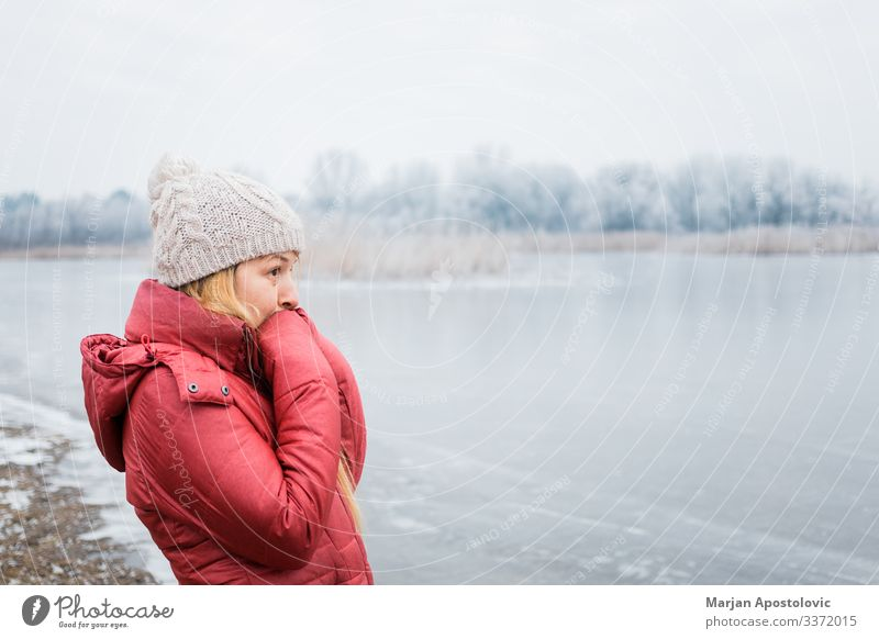 Young woman standing by the frozen lake in winter Lifestyle Adventure Winter Hiking Feminine Youth (Young adults) Woman Adults 1 Human being 30 - 45 years