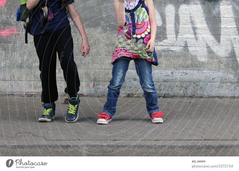 Human being Blue Town Red Joy Girl Street Graffiti Wall (building) Environment Movement Boy (child) Wall (barrier) Facade Gray Infancy