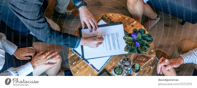 Top view of man signing a document Work and employment Office Business Company Internet Human being Woman Adults Man Hand Group Plant Cactus Aircraft Teamwork