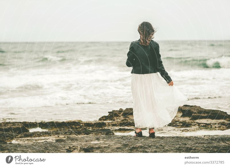 Back view of Pensive Young woman on the beach Lifestyle Elegant Style Beautiful Wellness Vacation & Travel Freedom Summer Beach Ocean Waves Human being Feminine