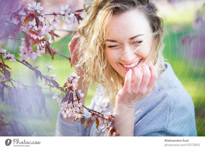 Woman enjoying the nature in spring Beautiful Beauty Photography Blossom Personal hygiene Considerate Cherry Cosmetics Face Finland Flower Garden Happiness