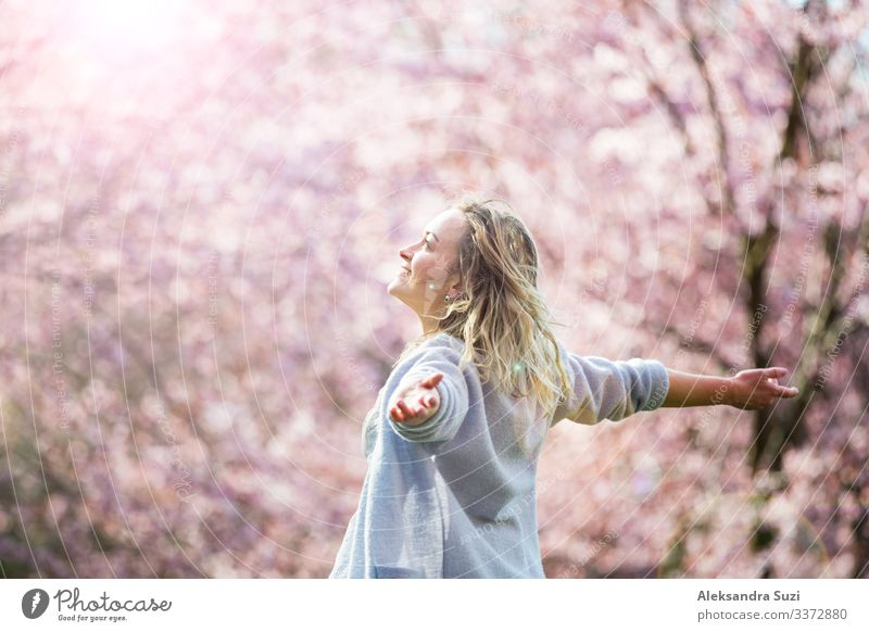 Woman enjoying the nature in spring Beautiful Beauty Photography Blossom Personal hygiene Cherry Cosmetics Face Finland Flower Garden Happiness Healthy