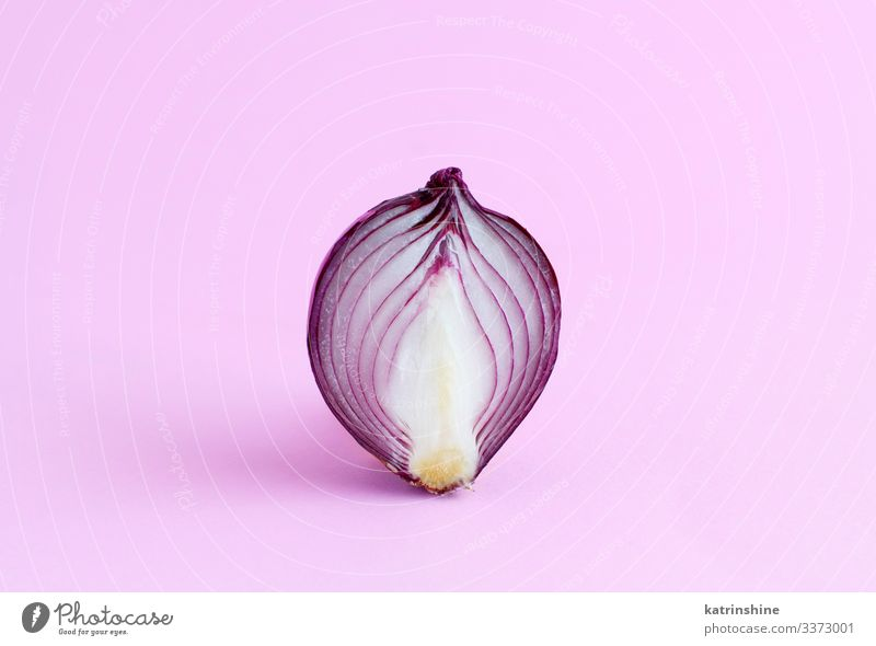 Purple onion on a light pink background Vegetable Vegetarian diet Fresh Natural Pink Red White Onion Sliced Half food healthy Monochrome Raw Organic Ingredients