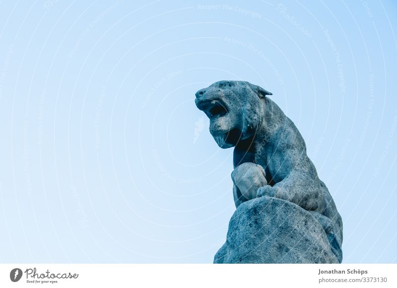 Sculpur mythical creature made of stone in front of a blue sky Animal portrait Contrast Shadow Light Day Neutral Background Colour photo Ancient