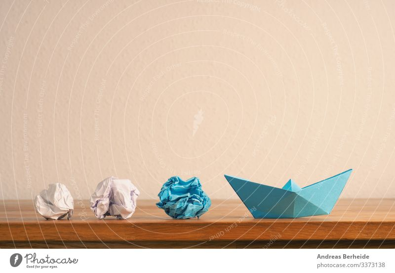 New ideas or teamwork concept with crumpled paper and paper boat background blue business color compass competition copy space creative creativity difference