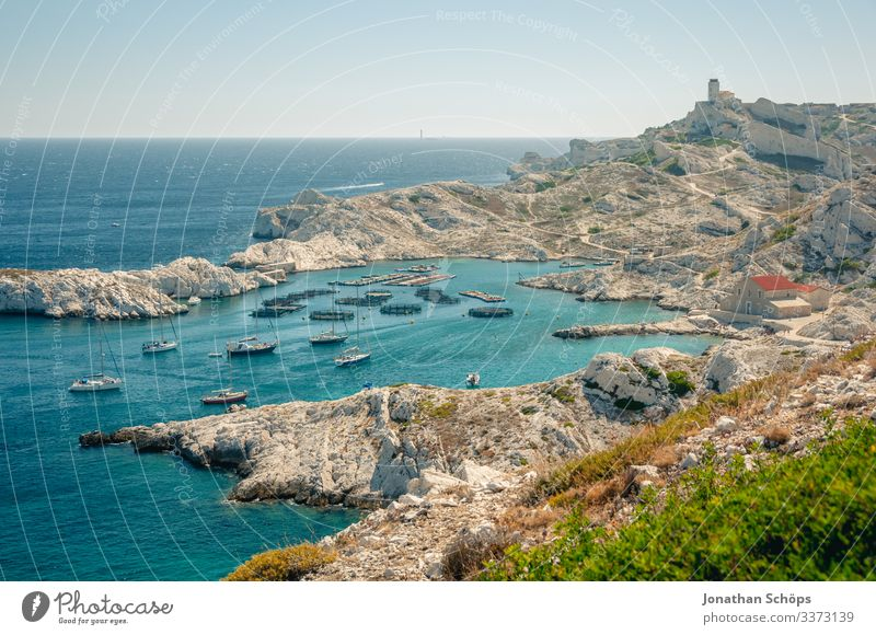 Fortress and port on island off Marseille Sunlight Light Day Copy Space top France Hot South Colour photo Southern France Ocean Mediterranean sea Rock formation